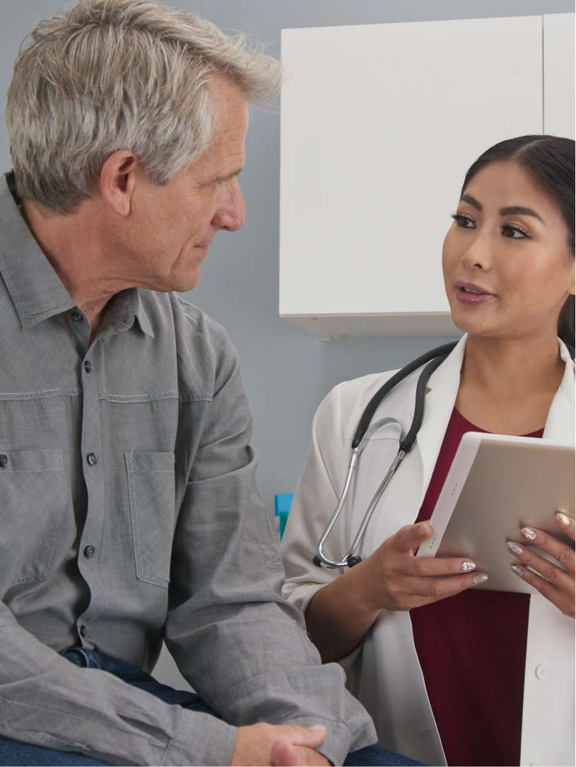 man talking with doctor - hyperuricemia section